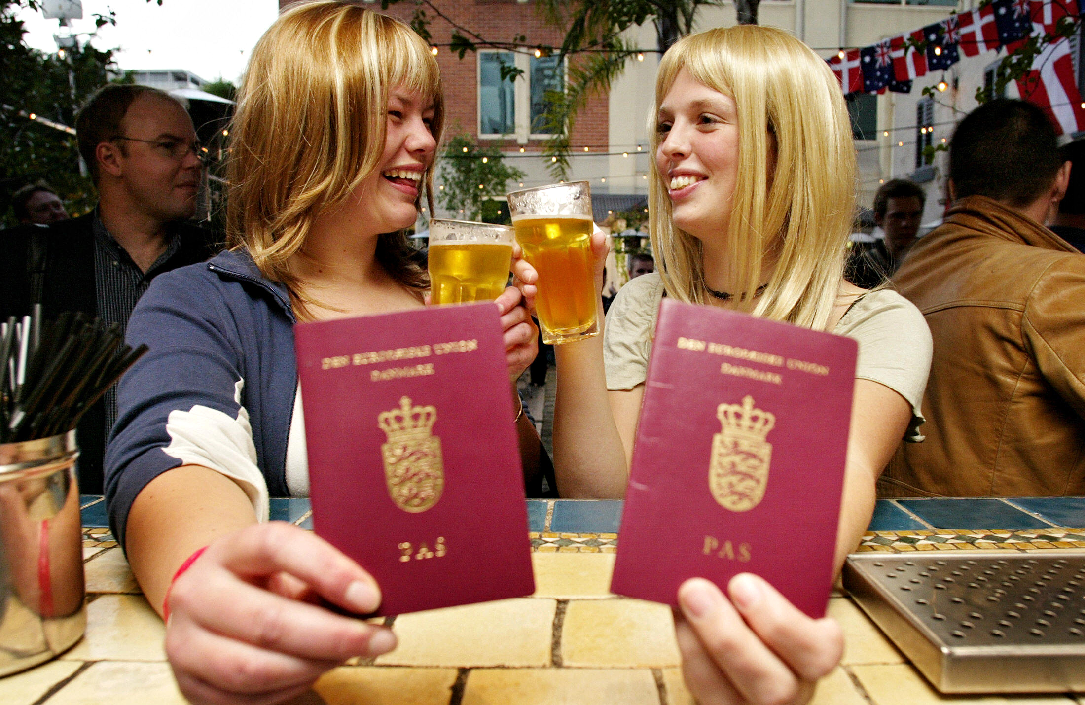 2 European Women Hold Their Native Country Passports for international travel